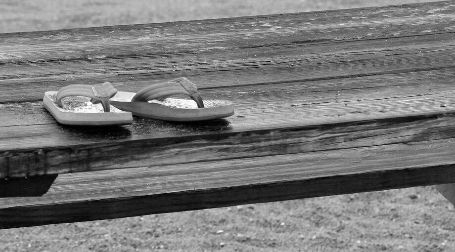 Flip flops abandoned at Sasco Beach Photo: Genevieve Reilly / Hearst Connecticut Media / Fairfield Citizen