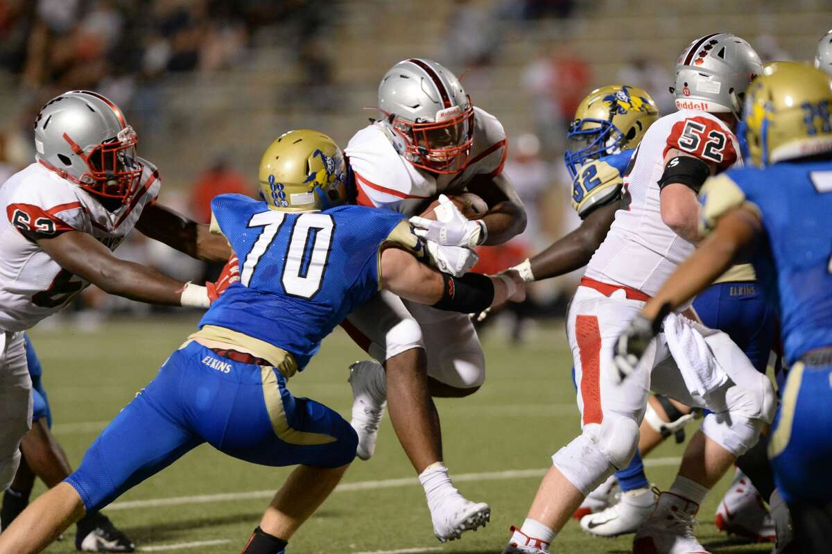 Kaelen Shankle (8) of Travis powers in for a one yard touchdown in the fourth quarter of a high school football game between the Elkins Knights and the Travis Tigers on Thursday, September 27, 2018 at Hall Stadium, Missouri City, TX.