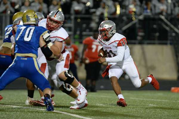Eric Rodriguez (11) of Travis carries the ball on a quarterback keeper in the third quarter of a high school football game between the Elkins Knights and the Travis Tigers on Thursday, September 27, 2018 at Hall Stadium, Missouri City, TX.