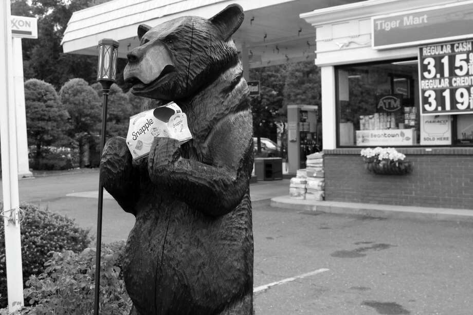 A bear figure holding a box of snapple drinks on Post Road in Darien. Taken Sept. 17 Photo: /Lynandro Simmons /Hearst Connecticut Media