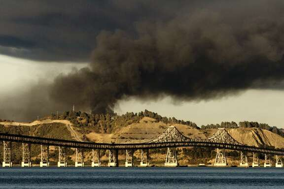 A plume of smoke from a 2012 fire at the Chevron Refinery in Richmond is seen from Tiburon.