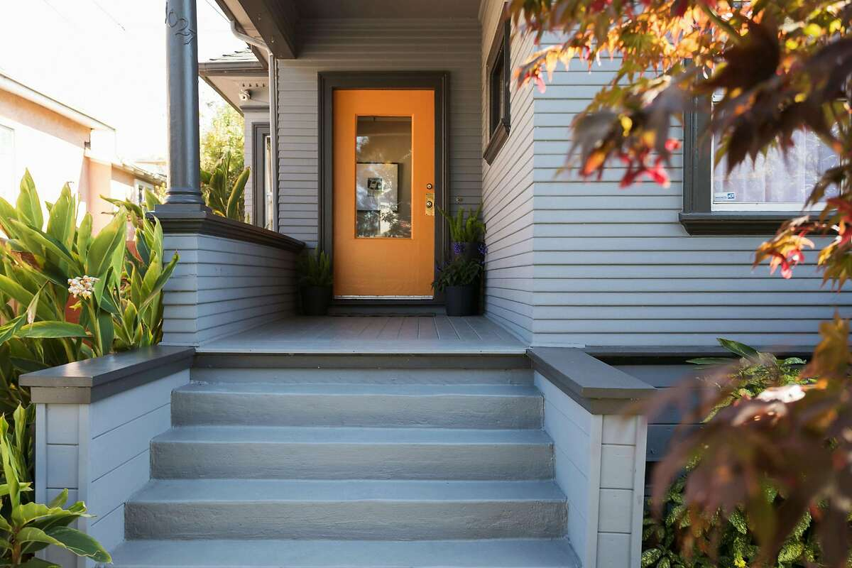 A covered porch waits before the Emeryville home.