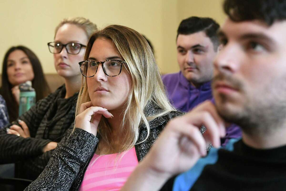 Students and faculty at Albany Law School watch Christine Blasey Ford appear in a charged hearing over Kavanaugh's nomination for the Supreme Court on Thursday, Sept. 27, 2018 in Albany, N.Y. (Lori Van Buren/Times Union)