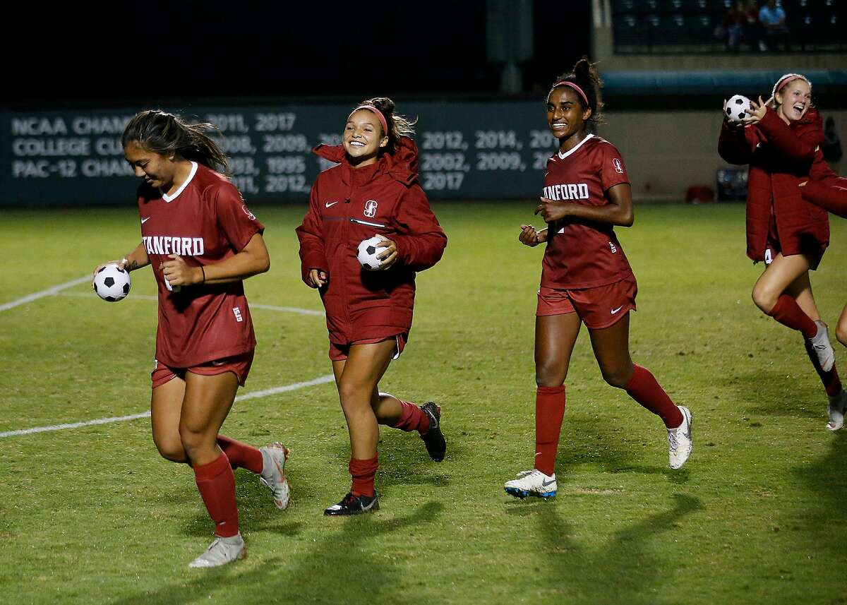 Stanford's Ceci Gee (13), left, Sophia Smith (3), Naomi Girma (2), and Abby Greubel (24) celebrate win against Arizona during the second half in an NCAA women college soccer game at Cagan Stadium in Stanford, Calif., on Sept. 21, 2018. (Josie Lepe/Special to the Chronicle)