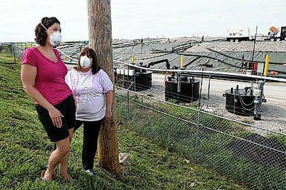 Activists Dawn Chapman (left) and Karen Nickel wear protective masks during a June 2017 visit to the West Lake Landfill in greater St. Louis. They wear the masks because they believe the site could be emitting hazardous particles. West Lake was an unlined mixed-waste landfill whose contents in a specific quadrant have been shown to include radioactive waste. The Environmental Protection Agency added West Lake to its National Priority List in 1990. On Thursday, EPA announced plans to dig up some of the illegally dumped nuclear waste buried near a long-smoldering underground fire at the landfill. Photo: Linda Davidson | The Washington Post | Getty Images