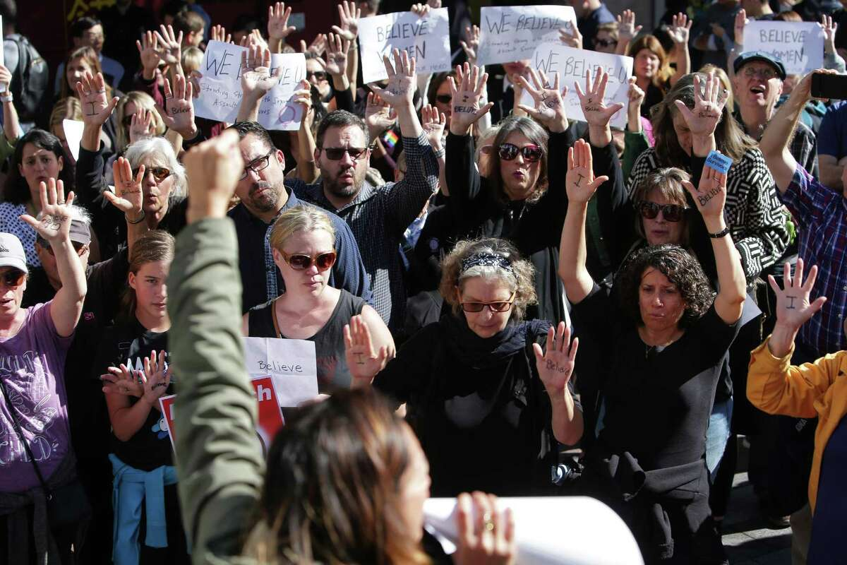 Several dozen people gathered at Westlake Park at noon, Thursday, to show their support for Dr. Christine Blasey Ford as she testifies in a Senate hearing today about her sexual assault allegations against Supreme Court nominee Brett Kavanaugh, Sept. 27, 2018. Many of the people gathered had experience sexual assault themselves and shared their stories. The event ended with a minute of silence in honor of victims of sexual violence. (Genna Martin, seattlepi.com)