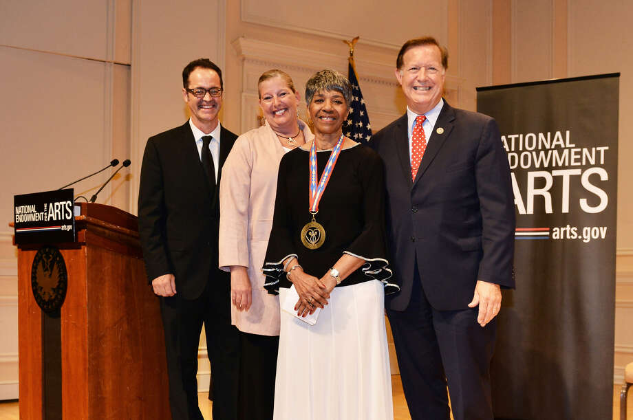 R&B musician Barbara Lynn from Beaumont, Texas, is presented with a medal in honor of her 2018 NEA National Heritage Fellowship by National Endowment for the Arts Acting Chairman Mary Anne Carter, Director of Folk and Traditional Arts Clifford Murphy (left), and Congressman Randy Weber (right) at the 2018 NEA National Heritage Fellowships Awards Ceremony on September 26, 2018. Photo: Photo By Tom Pich