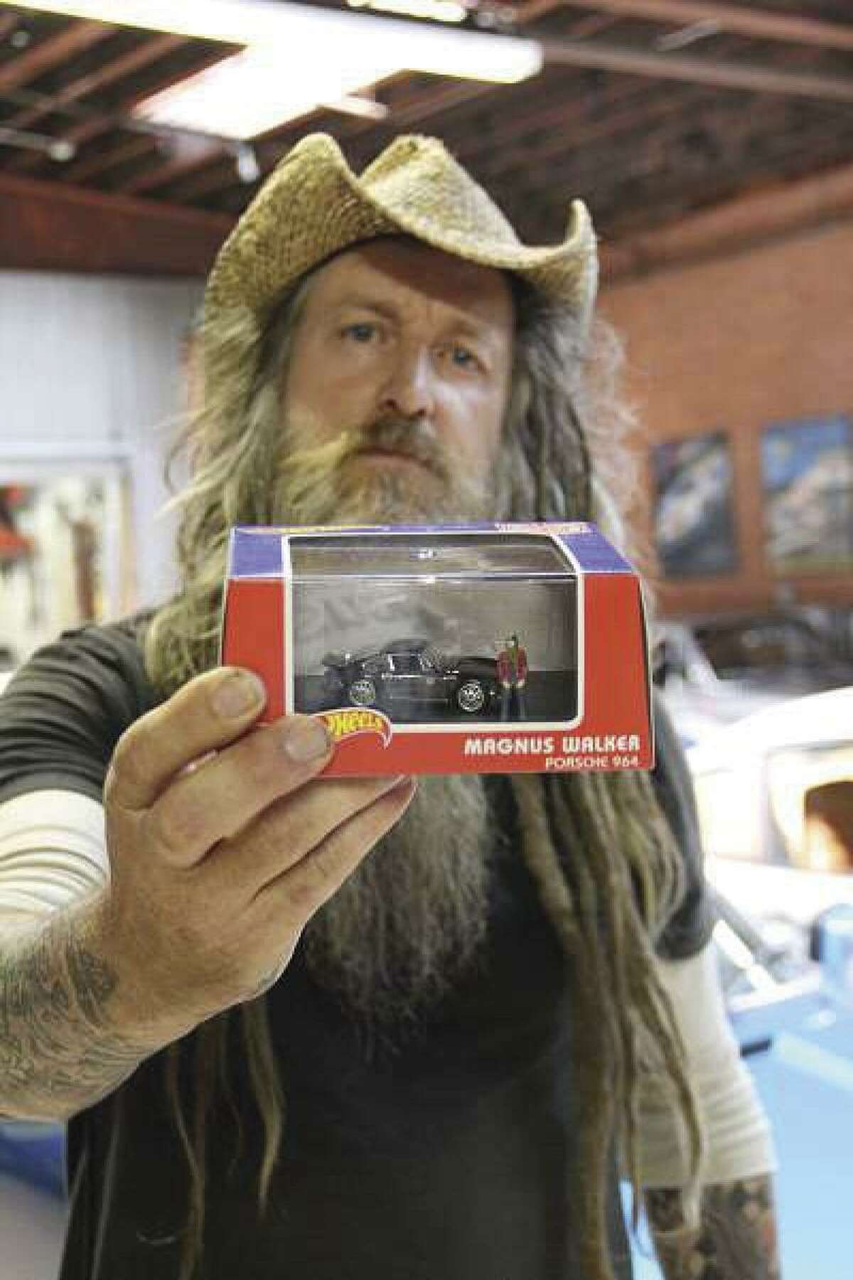 Magnus Walker, one of the most prominent personalities in the car world, holds his new specialty edition Hot Wheel with figurine. (Photo by Heidi Van Horne)