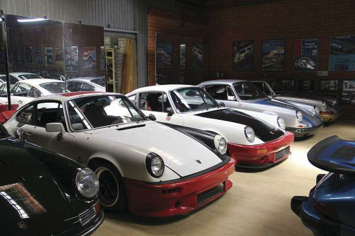 Walker's affection for Porsches began at the age of 10, in 1977 in England, when his dad took him to an auto show. Shown is his Porsche 911 collection. (Photo by Heidi Van Horne)