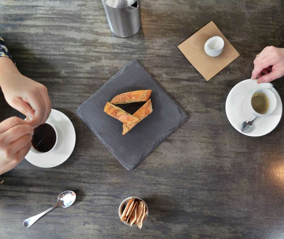 The Grove HoustonThe Grove will offer customers half off French press pots accompanied with free homemade biscotti. Small size press pots serve 2.5 cups of coffee for $5 and large press pots serve 5 cups of coffee for $9. Photo: The Grove Houston