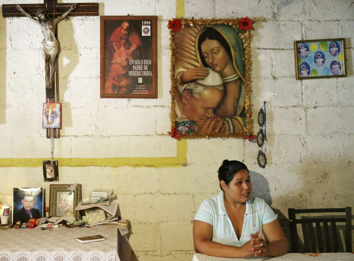 """Maria de los Dolores Romero Medina, 36, sits in a room surrounded by an altar dedicated to her late son, Jose Eugenio Hernandez Romero, 14, in Nuevo Laredo, Mexico, Monday, Sept. 24, 2018. Her son was detained by Mexican marines on April 23rd at a convenience store according to witnesses. Two other people went missing at the same store 10 days earlier. The teen?'s body along with a woman?'s body were found a day later in a clandestine grave. Dozens of persons are missing and some have been found dead in Nuevo Laredo and human rights activist along with families of the missing blame the Mexican marines. ?""""Many of these people are reported to have been arbitrarily detained and disappeared while going about their daily lives,?"""" UN High Commissioner for Human Rights Zeid Ra?'ad Al Hussein said in late May, in calling for an investigation into the marine?'s actions. ?""""These crimes, perpetrated over four months in a single municipality, are outrageous.?"""""""