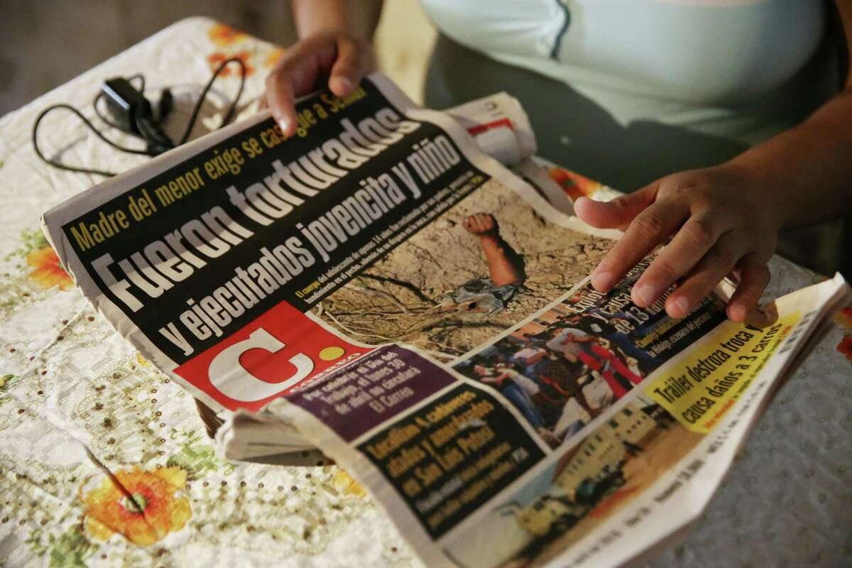 """During an interview at her house in Nuevo Laredo, Mexico on Monday, Sept. 24, 2018, Maria de los Dolores Romero Medina, 36, shows newspaper articles on her son death. Her son was detained by Mexican marines on April 23rd at a convenience store according to witnesses. Two other people went missing at the same store 10 days earlier. The teen?•s body along with a woman?•s body were found a day later at a clandestine grave. Dozens of persons are missing and some have been found dead in Nuevo Laredo and human rights activist along with families of the missing blame the Mexican marines. ?'Many of these people are reported to have been arbitrarily detained and disappeared while going about their daily lives,?"""" UN High Commissioner for Human Rights Zeid Ra?•ad Al Hussein said in late May, in calling for an investigation into the marine?•s actions. ?'These crimes, perpetrated over four months in a single municipality, are outrageous.?"""""""