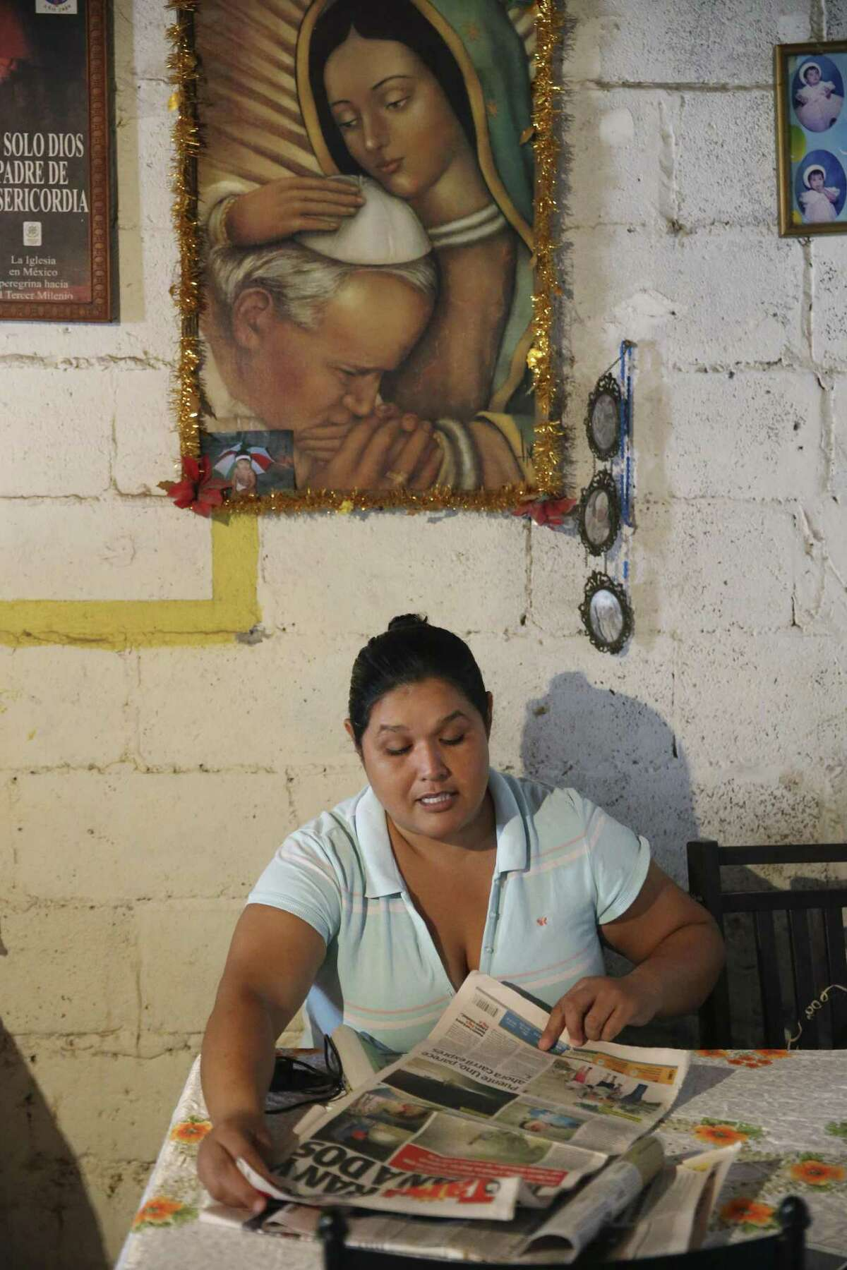 During an interview at her house in Nuevo Laredo, Mexico on Monday, Sept. 24, 2018, Maria de los Dolores Romero Medina, 36, shows newspaper articles on her son death. Her son was detained by Mexican marines on April 23rd at a convenience store according to witnesses. Two other people went missing at the same store 10 days earlier. The teen?•s body along with a woman?•s body were found a day later at a clandestine grave.