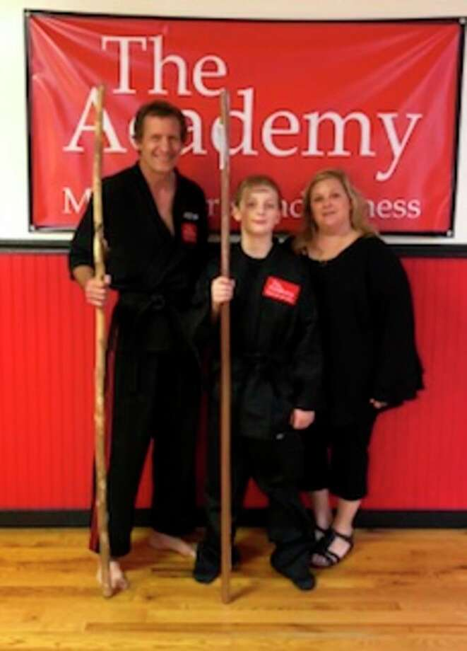 Adam Nietling, center, recently earned The Academy Black Belt from The Academy Martial Arts and Fitness. At left is Craig Sira and at right is Laura Sira.
