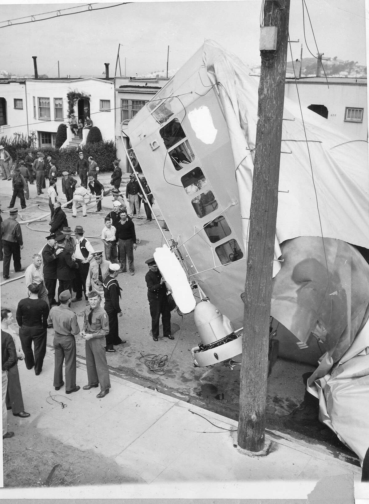 Crowds gathered to look at the crashed, empty blimp. Officials from the Navy came around and confiscated photographs from the crowd.