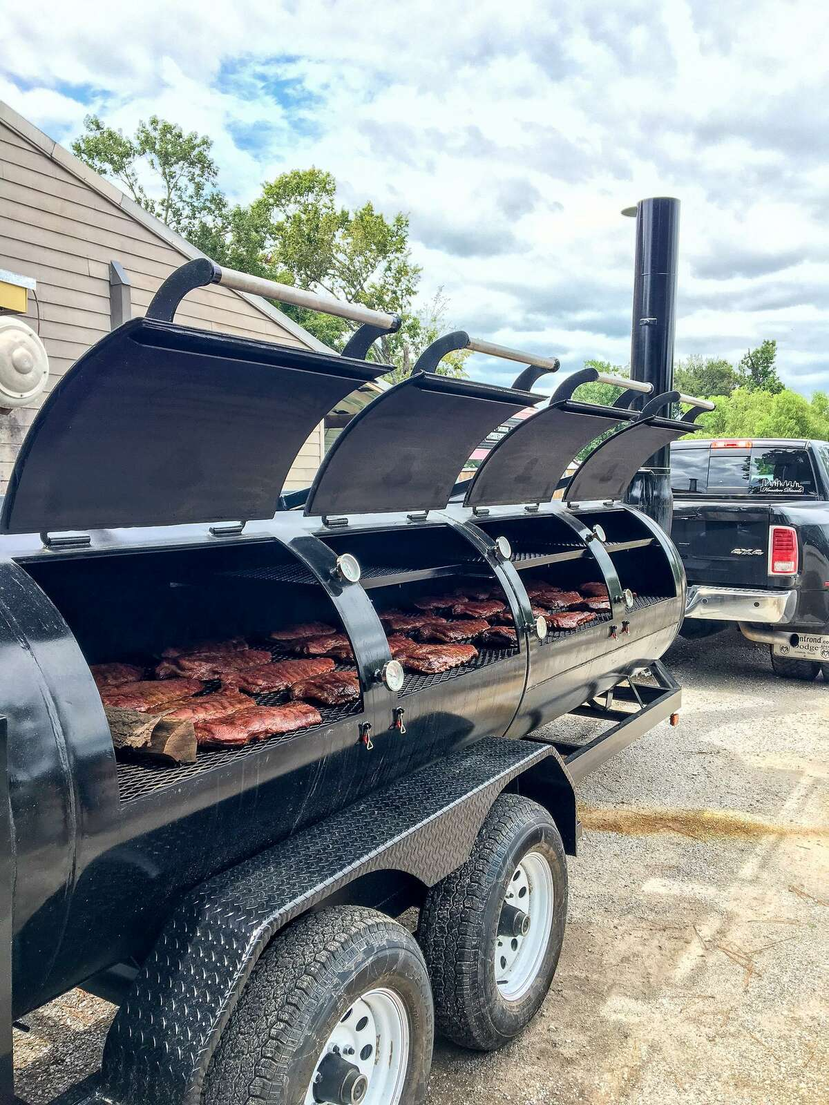 A trailer-mounted, 1000-gallon Moberg smoker at CorkSCrew BBQ in Spring.