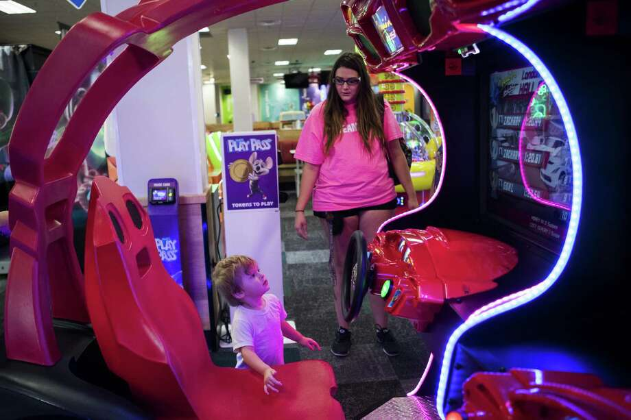 Scotty Birdwell, 2, accompanied by his mother Samantha Luce shows interest for a racing cars game at the new Chuck E. Cheese's game room, Thursday, Sept. 27, 2018, in Houston. Photo: Marie D. De Jesús, Houston Chronicle / Staff Photographer / © 2018 Houston Chronicle