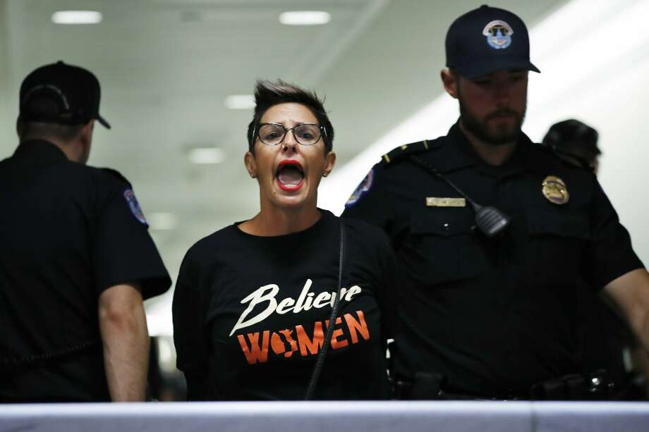 A woman protesting Supreme Court nominee Brett Kavanaugh is removed from the hallway near the Senate Judiciary Committee hearing room after being arrested by Capitol Police, Friday, Sept. 28, 2018, on Capitol Hill in Washington. (AP Photo/Jacquelyn Martin) Photo: Jacquelyn Martin/AP