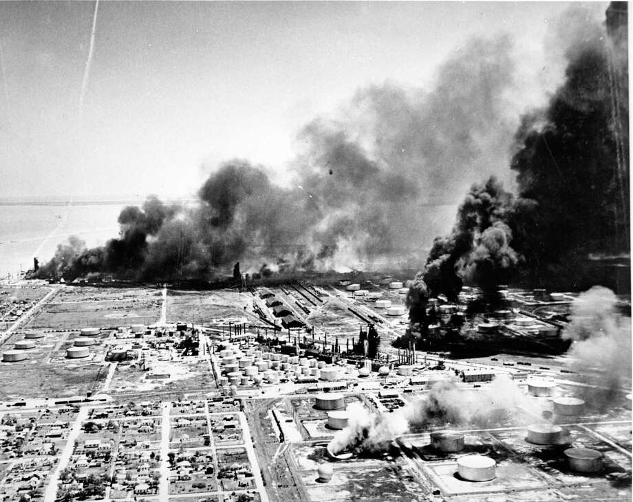 April 17, 1947: A huge oil storage tank belches a cloud of smoke in a new danger area following the Texas City explosion. Photo: Bud Bigelow, HP Staff / Houston Chronicle / Houston Chronicle