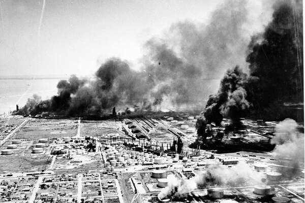 04/17/1947 - A huge oil storage tank belches a cloud of smoke in a new danger area at Texas City Thursday afternoon. As flames and explosions moved into the area dotted by row on row of huge fuel containers, officials gave up hope of saving them.