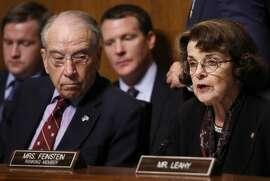 Senate Judiciary Committee Chairman Chuck Grassley (R-IA) listens as ranking member Dianne Feinstein (D-CA) speaks during a contentious committee meeting September 28, 2018 in Washington, DC. The committee met to discuss and later vote on the nomination of Judge Brett Kavanaugh to the U.S. Supreme Court prior to the nomination proceeding to a vote in the full U.S. Senate.