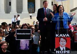 Demonstrators protesting against Judge Brett Kavanaugh's nomination as an Associate Justice on the Supreme Court lissetn to Senators Richard Blumenthal (D-CT) (3R), Kamala Harris (D-CA) (C), and Mazie Hirono (D-HI) in front of the Supreme Court in Washington, DC, September 28, 2018. - Kavanaugh's contentious Supreme Court nomination will be put to an initial vote Friday, the day after a dramatic Senate hearing saw the judge furiously fight back against sexual assault allegations recounted in harrowing detail by his accuser. (Photo by Eric BARADAT / AFP)ERIC BARADAT/AFP/Getty Images