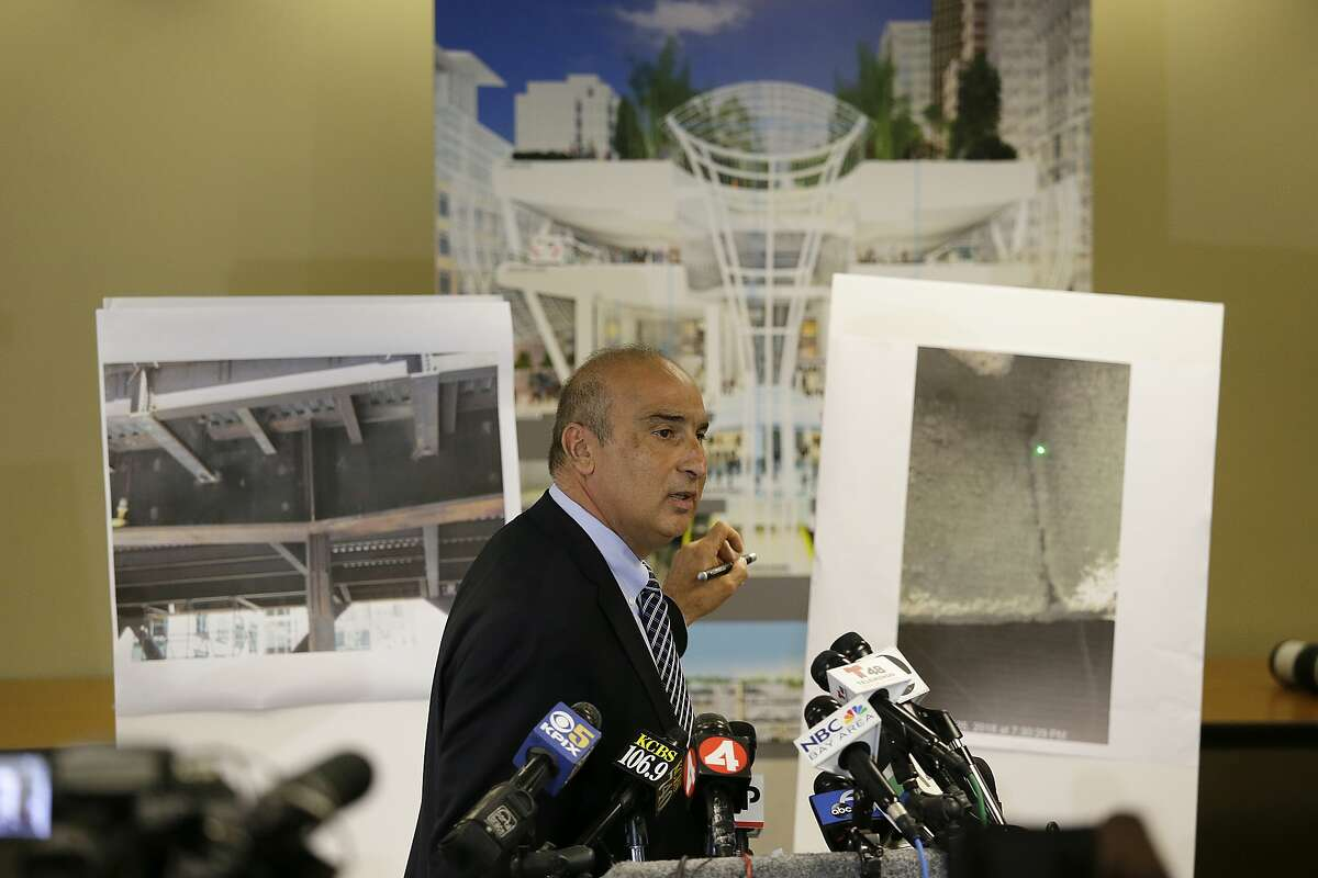 Mark Zabaneh, Executive Director of the Transbay Joint Powers Authority, points to a photograph showing a a cracked steel beam found in the Salesforce Transit Center, during a news conference Wednesday, Sept. 26, 2018, in San Francisco. A second beam in San Francisco's celebrated new $2 billion transit terminal shows signs of cracking, an official said Wednesday, a day after a crack in a nearby support beam shut down the building that opened just last month. (AP Photo/Eric Risberg)
