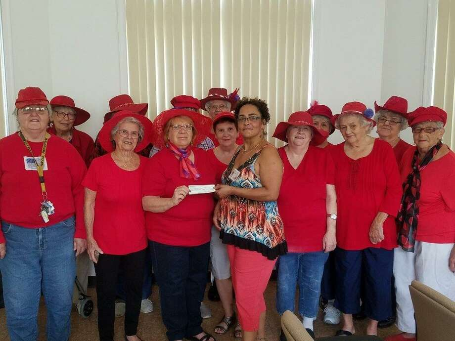 The Red Hat Ladies Club recently made a $500 donation to the Amazing Grace Food Pantry. Photo: Contributed Photo