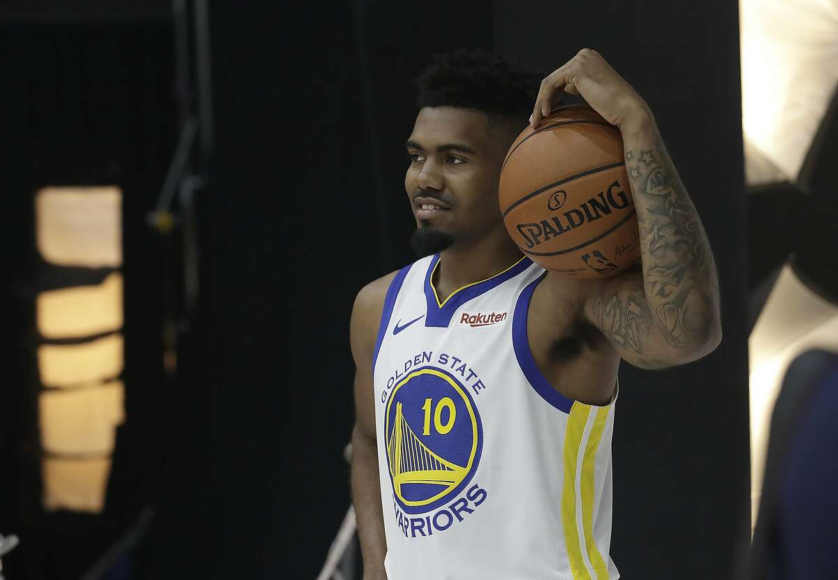 Golden State Warriors' Jacob Evans III poses for photos during media day at the NBA basketball team's practice facility in Oakland, Calif., Monday, Sept. 24, 2018. (AP Photo/Jeff Chiu)