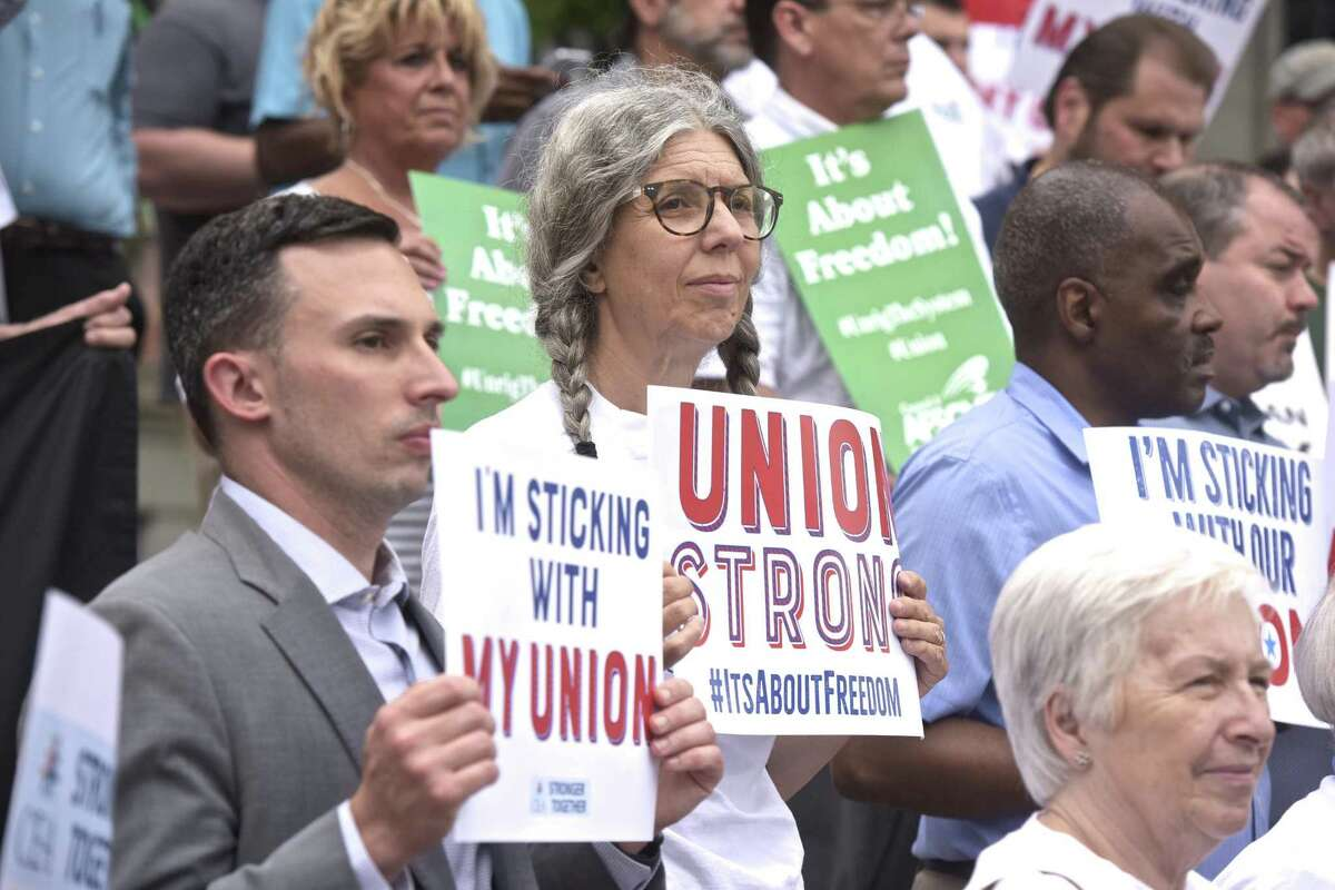 Union members and labor leaders stand on the steps of the Connecticut Supreme Court this summer in response to the U.S. Supreme Court on Janus v. AFSCME Council case.