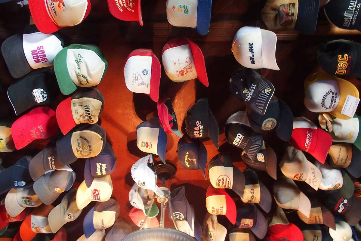 Some of the thousands of hats that decorate the ceiling of the bar at Giusti's Place in Walnut Grove.