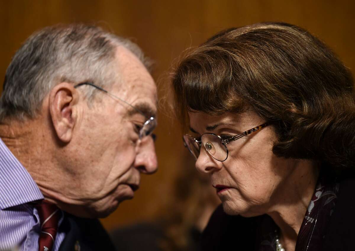 US Senate Judiciary Committee chair Chuck Grassley (L) (R-IA) speaks with Democratic US Senator Dianne Feinstein during a hearing on Capitol Hill in Washington, DC on September 28, 2018, on the nomination of Brett M. Kavanaugh to be an associate justice of the Supreme Court of the United States. - Kavanaugh's contentious Supreme Court nomination will be put to an initial vote Friday, the day after a dramatic Senate hearing saw the judge furiously fight back against sexual assault allegations recounted in harrowing detail by his accuser.