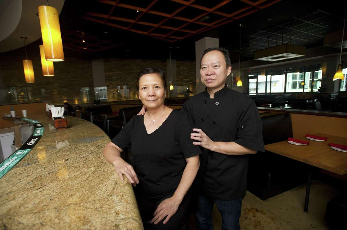 Peter Chang, owner of Peter Chang Restaurant, and his wife, Lisa, stand in the new restaurant, which is located in the restaurant row of Stamford Town Center mall, at 230 Tresser Blvd., on Wednesday, Sept. 26, 2018.