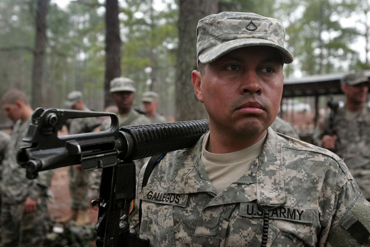 Marco Gallegos, 33, of New York City waits to have his weapon inspected during Army basic training at Fort Jackson March 1, 2007 in Columbia, South Carolina.