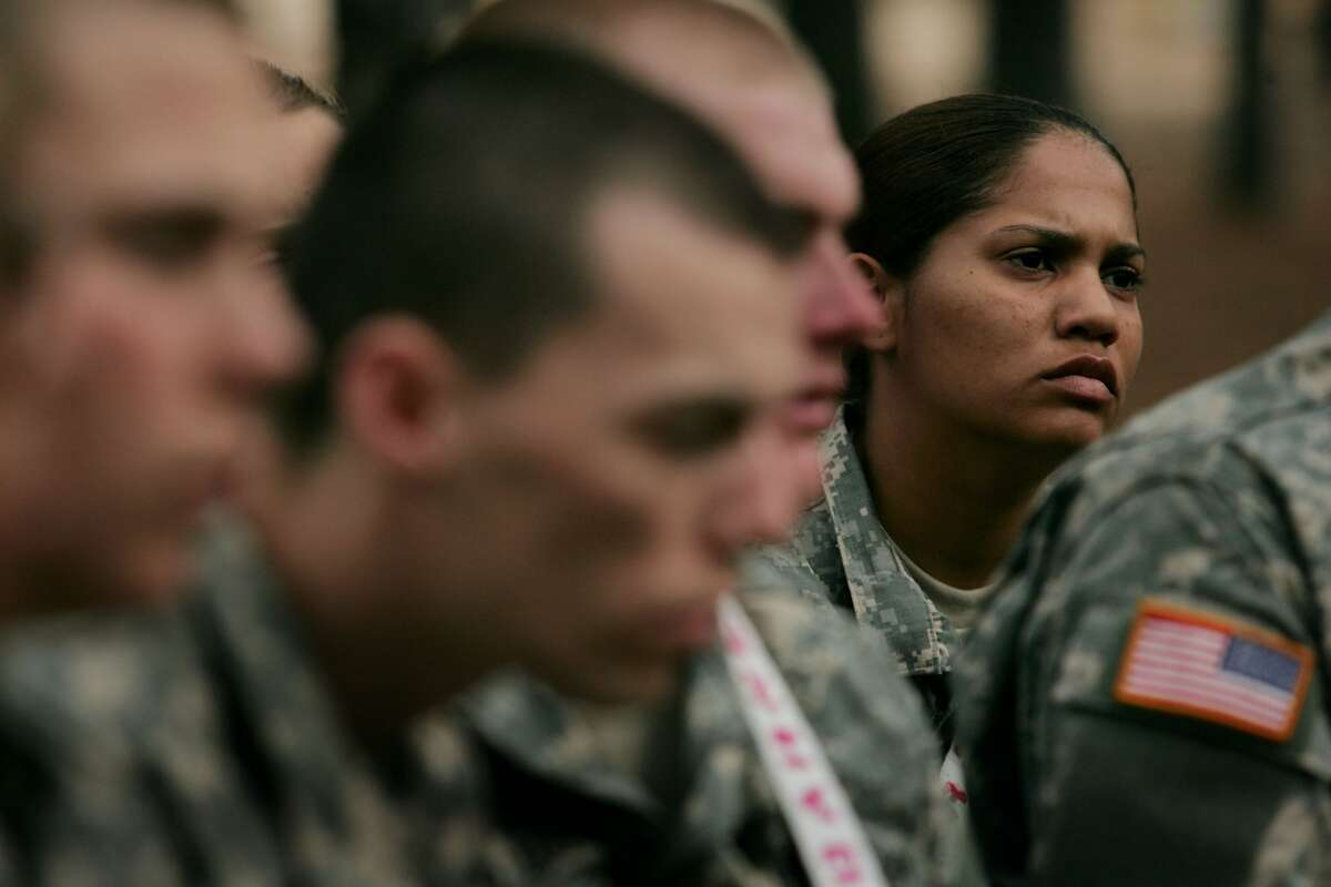 Sylvia Solis, 29, of Guaynabo, Puerto Rico listens to instructions at a teamwork drill during Army basic training at Fort Jackson March 1, 2007 in Columbia, South Carolina.