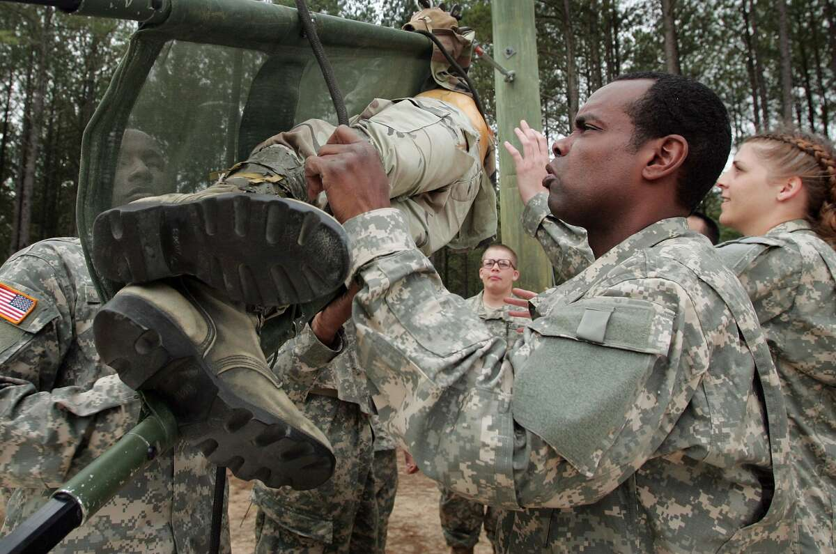 Brian Elisha, 40, of Burlington, New Jersey helps fellow soldiers at a teamwork drill during Army basic training at Fort Jackson March 1, 2007 in Columbia, South Carolina.