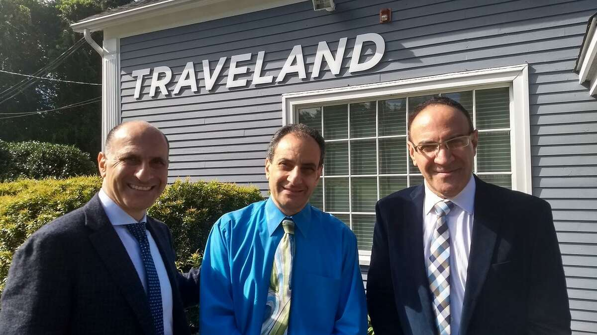 From left to right: Tamir, Oded ane Eitan Battat just expanded their Traveland officein a move to Orange.