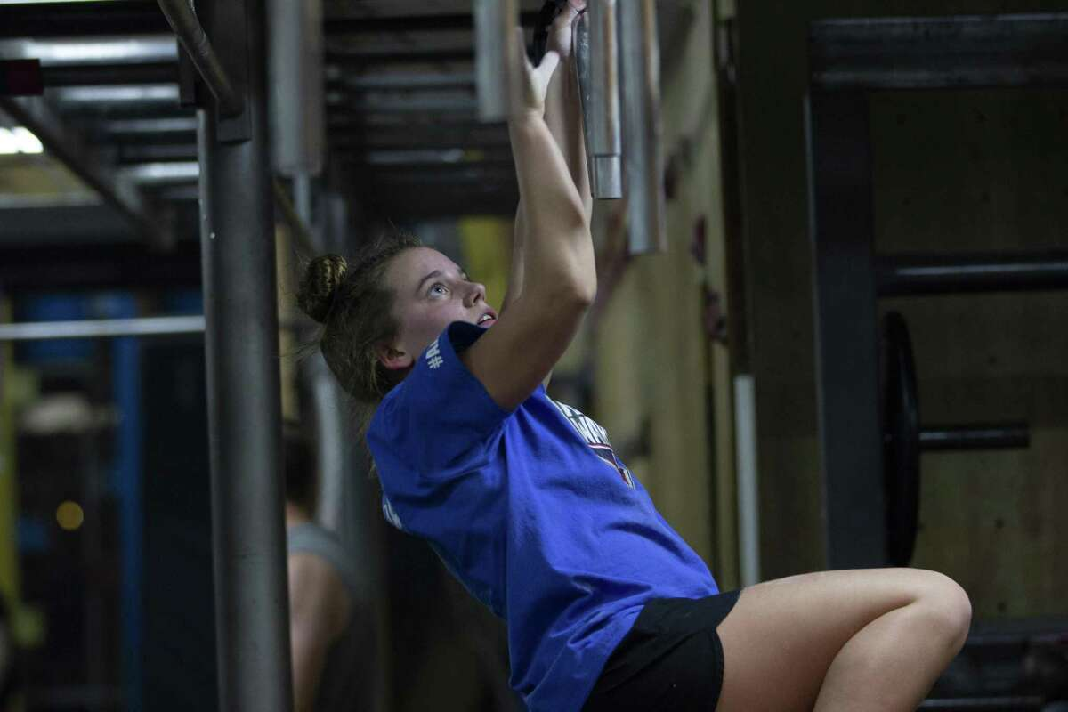 """Ryleigh Rodgers, 14, swings from nunchucks at Iron Sports Indoor Obstacle Course on Thursday, Spet. 27, 2018 in Houston. Rodgers competed in ?""""American Ninja Warrior Jr.?"""" which will air Oct. 13."""