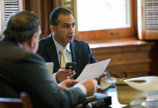Rep. Abel Herrero, chair of the Land and Resource Management committee, reads aloud a bill as he prepares to take a vote within the committee at the Texas State Capitol to revive annexation legislation after it stalled on the house floor on Monday during special session of the 85th Texas Legislature on August 9, 2017 in Austin, Texas. Photo: Thao Nguyen / Thao Nguyen