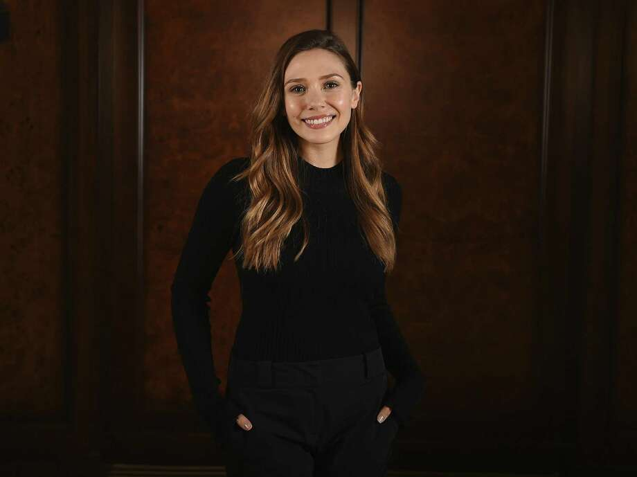 "Elizabeth Olsen stars in the Facebook Watch series ""Sorry For Your Loss,"" where she plays a young woman named Leigh who is dealing with the sudden loss of her husband. Photo: Jordan Strauss, INVL / Associated Press / 2018 Invision"