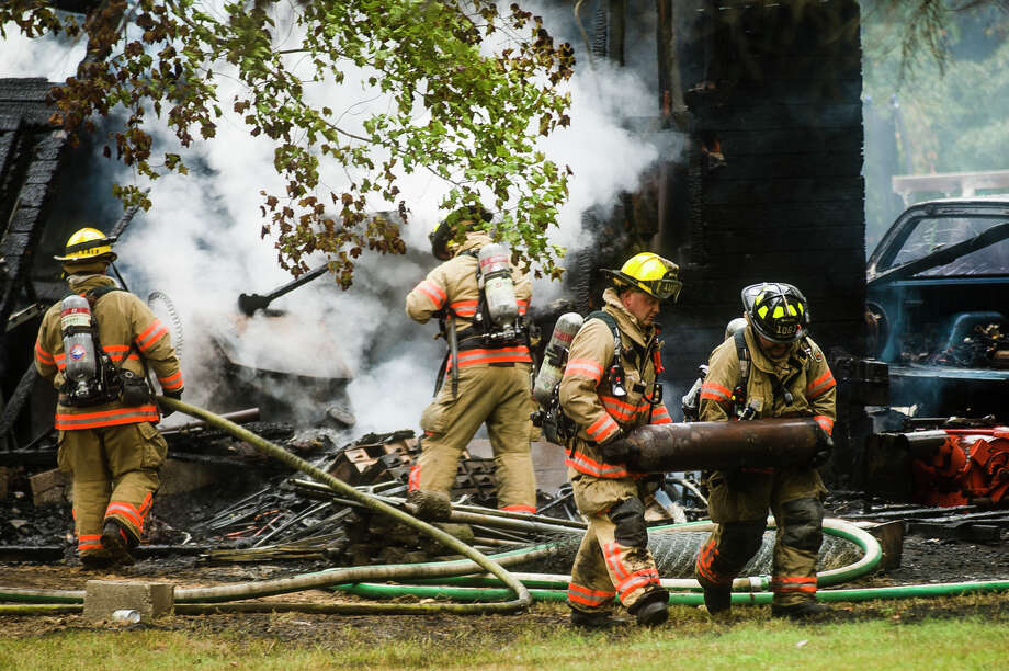 Firefighters with the City of Midland Fire Department respond to a house fire Friday, Sept. 28, 2018 at 8414 Sturgeon Avenue between Letts and Monroe. No one was injured in the fire. (Katy Kildee/kkildee@mdn.net) Photo: (Katy Kildee/kkildee@mdn.net)