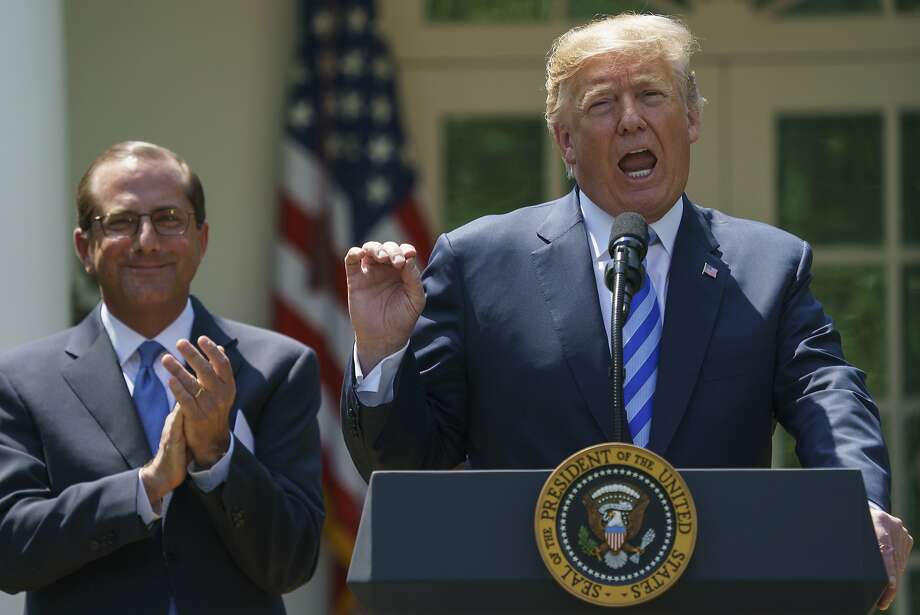 President Trump talks in May about prescription drug prices as Health and Human Services Secretary Alex Azar stands by. Photo: Carolyn Kaster / Associated Press