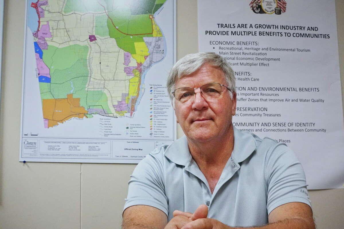 Ed Kinowski, Stillwater town supervisor, poses at Stillwater Town Hall with a Town of Stillwater Official Zoning Map on Tuesday, Sept. 4, 2018, in Stillwater, N.Y. (Paul Buckowski/Times Union)
