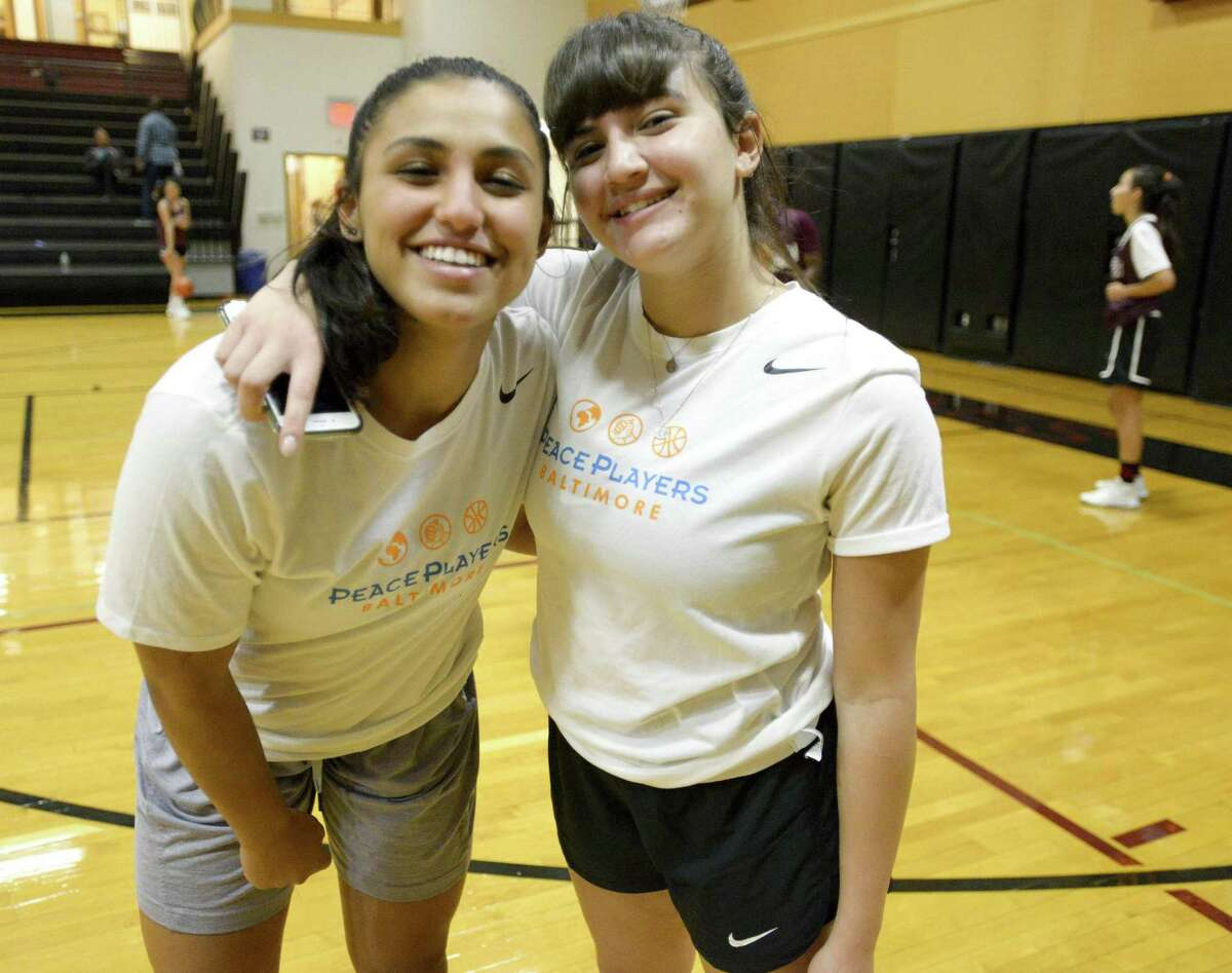 From left, Nitzan Daniel and Jenan Maharmeh, teammates on the PeacePlayers-Middle East All Stars are photographed prior to a goodwill basketball game against the St. Luke's varsity girls basketball team on Wednesday, Sept. 26, 2018 in New Canaan, Connecticut. The group of Arab and Israeli girls have grown up playing basketball together in the PeacePlayers Middle East program and have been touring the United States promoting peace and goodwill.