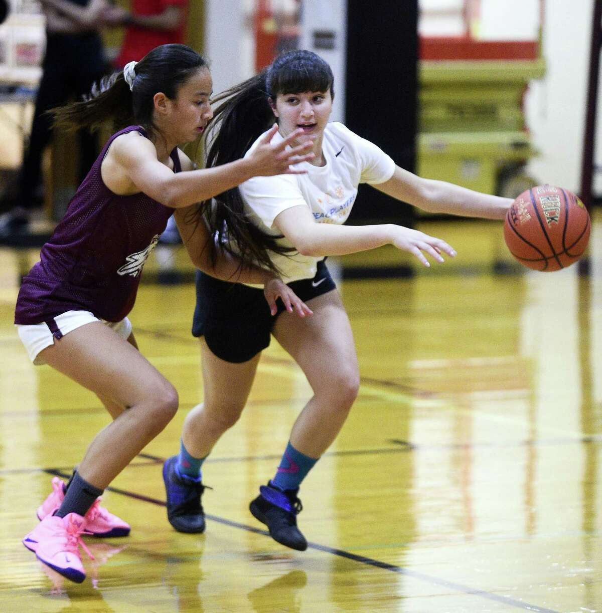 St. Luke's Caroline Lau defends the drive of Jenan Maharmeh of the PeacePlayers-Middle East All Stars during a Goodwill basketball game on Wednesday, Sept. 26, 2018 in New Canaan, Connecticut. A group of Arab and Israeli girls who have grown up playing basketball together in the PeacePlayers Middle East program, have been touring the United States promoting Peace and Goodwill.