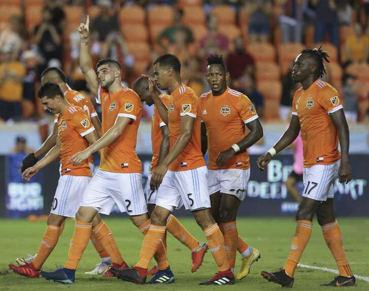 Houston Dynamo players gather to celebrate Alejandro Fuenmayor's (2) goal at the 81st minute in the second half of the MLS game against the Portland Timbers at BBVA Compass Stadium on Saturday, Sept. 15, 2018, in Houston. The Houston Dynamo defeated the Portland Timbers 4-1.
