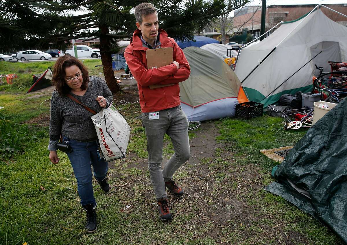 ( l to r ) Wilma Lozada, outreach team member and Dr. Colin Buzza during a visit to a homeless encampment near Lake Merritt in Oakland, Calif., on Thurs. Mar.1, 2018. Alameda County Health Services has just launched a new street medicine program in which psychiatrists go into encampments specifically to provide treatment for opioid addiction and mental illness.