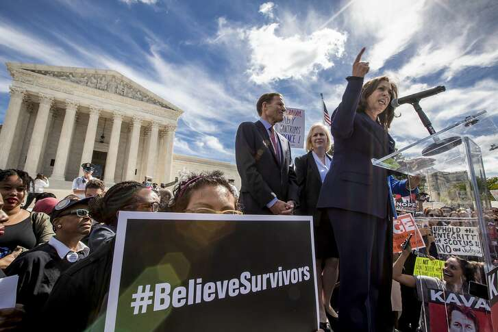 From left, Sen. Richard Blumenthal, D-Conn., Sen. Kirsten Gillibrand, D-N.Y., and Sen. Kamala Harris, D-Calif., speak as protesters rally against Supreme Court nominee Brett Kavanaugh as the Senate Judiciary Committee debates his confirmation, Friday, Sept. 28, 2018, at the Supreme Court in Washington. (AP Photo/J. Scott Applewhite)