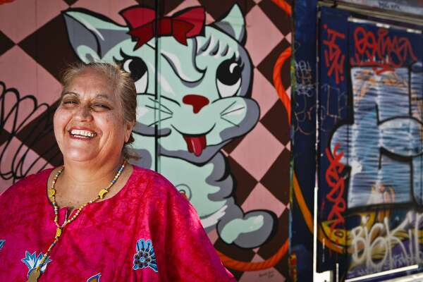 Virginia Ramos aka the Tamale Lady stands in Clarion Alley on Wednesday, July 6, 2011 in San Francisco, Calif.