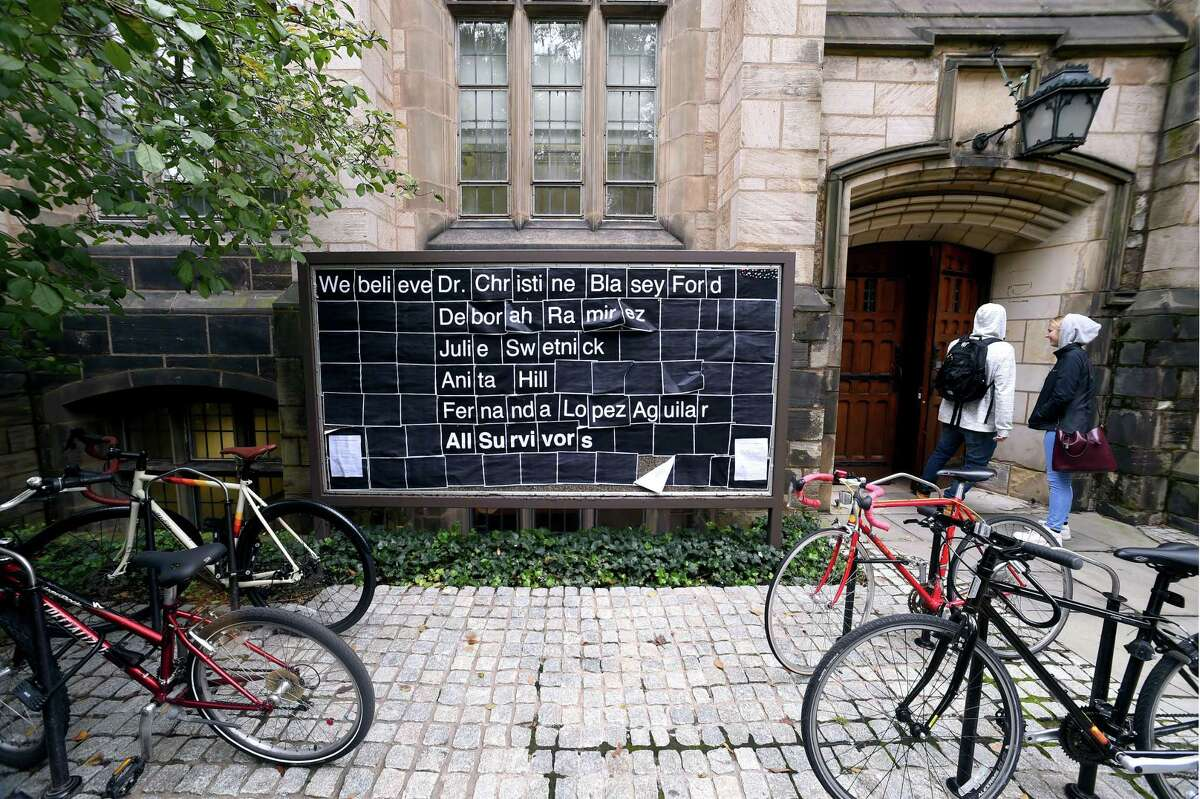 A bulletin board outside Yale University's Harkness Hall in New Haven displays support fro Christine Blasey Ford and other sexual assault survivors on Friday.